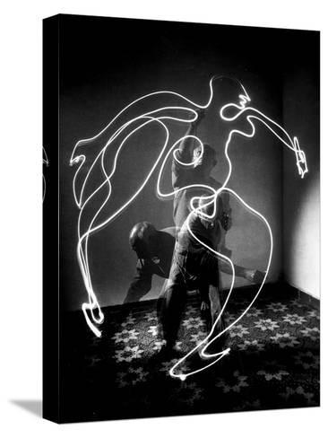 Multiple Exposure of Artist Pablo Picasso Using Flashlight to Make Light Drawing of a Figure-Gjon Mili-Stretched Canvas Print