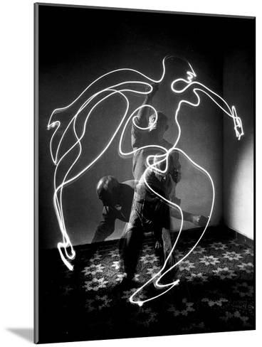 Multiple Exposure of Artist Pablo Picasso Using Flashlight to Make Light Drawing of a Figure-Gjon Mili-Mounted Premium Photographic Print