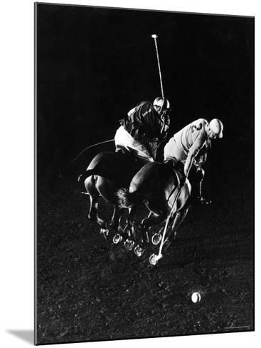 William Nicholls and William Rand of Squadron Polo Team Indoor Polo at National Guard Armory, NYC-Gjon Mili-Mounted Premium Photographic Print