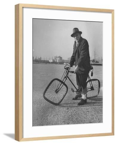 Eccentric Square-Wheeled Bicycle-Wallace Kirkland-Framed Art Print