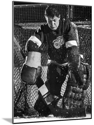 Terry Sawchuck, Star Goalie for the Detroit Red Wings, Warding Off Shot on Goal, at Ice Arena-Joe Scherschel-Mounted Premium Photographic Print