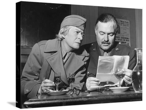 Ernest Hemingway and Janet Flanner-David Scherman-Stretched Canvas Print