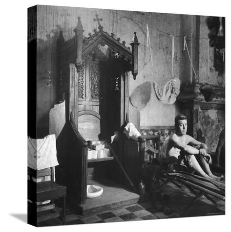 Grave Soldier on Cot Next to Ornate Confessional in Makeshift Hospital in Cens Cathedral-W^ Eugene Smith-Stretched Canvas Print