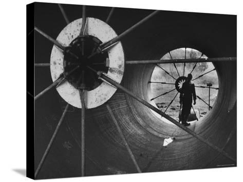 Part of 108 Inch Pipe That Will Be Used to Divert Water from the Jordan River to Negev Desert-Paul Schutzer-Stretched Canvas Print