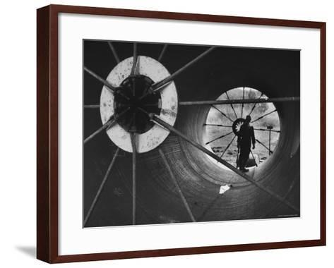 Part of 108 Inch Pipe That Will Be Used to Divert Water from the Jordan River to Negev Desert-Paul Schutzer-Framed Art Print