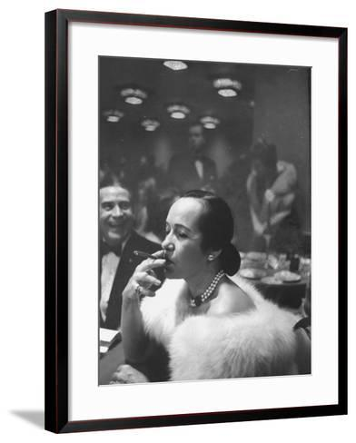 Woman Tries Lady's Cigar in Club After Release of Surgeon General's Report on Smoking Hazards-Ralph Morse-Framed Art Print