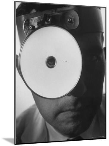 Closeup of a Doctor Wearing a Mask of His Profession-Andreas Feininger-Mounted Photographic Print