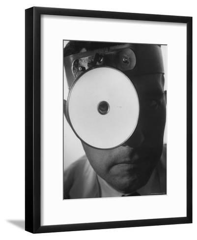 Closeup of a Doctor Wearing a Mask of His Profession-Andreas Feininger-Framed Art Print