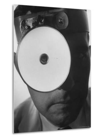 Closeup of a Doctor Wearing a Mask of His Profession-Andreas Feininger-Metal Print