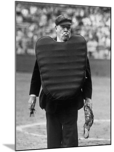 Umpire Bill Summers Glaring Toward Cleveland Indians Dugout-George Silk-Mounted Premium Photographic Print