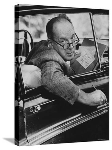 Author Vladimir Nabokov Writing in His Car. He Likes to Work in the Car, Writing on Index Cards-Carl Mydans-Stretched Canvas Print