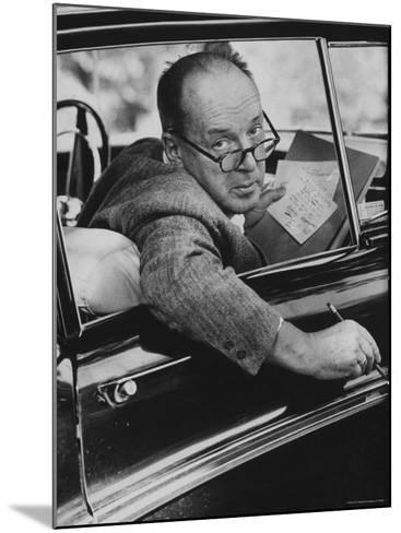 Author Vladimir Nabokov Writing in His Car. He Likes to Work in the Car, Writing on Index Cards-Carl Mydans-Mounted Premium Photographic Print