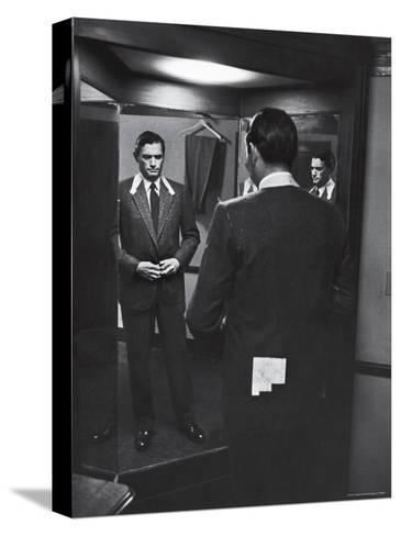 Gregory Peck Trying on Suit for His New Movie Man in the Grey Flannel Suit-Michael Rougier-Stretched Canvas Print