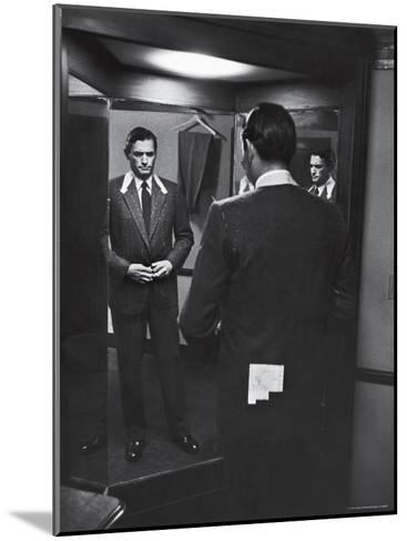 Gregory Peck Trying on Suit for His New Movie Man in the Grey Flannel Suit-Michael Rougier-Mounted Premium Photographic Print