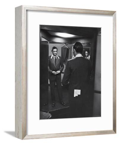 Gregory Peck Trying on Suit for His New Movie Man in the Grey Flannel Suit-Michael Rougier-Framed Art Print