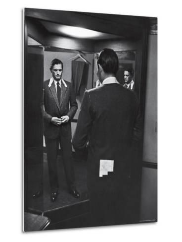Gregory Peck Trying on Suit for His New Movie Man in the Grey Flannel Suit-Michael Rougier-Metal Print