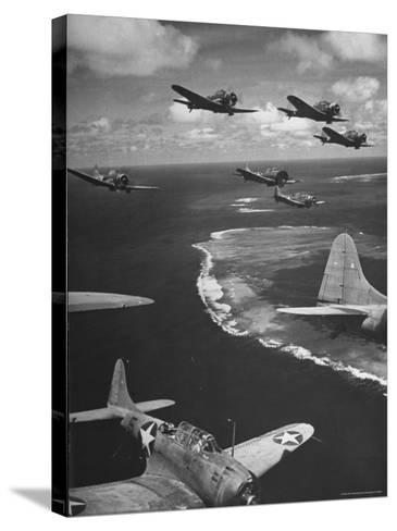 Squadron of US Douglas SBD3 Dive Bombers in Flight, Patrolling Coral Reefs Off Midway Island-Frank Scherschel-Stretched Canvas Print