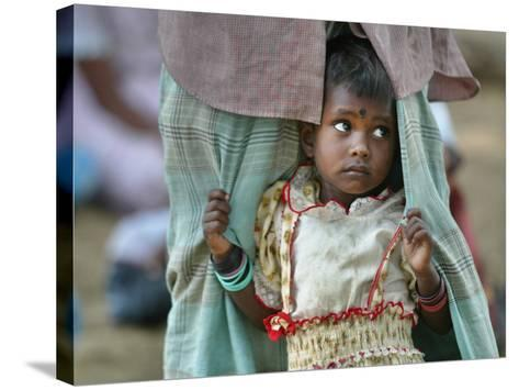 A Displaced Tamil Child Hangs to Her Father's Sarong-Gemunu Amarasinghe-Stretched Canvas Print