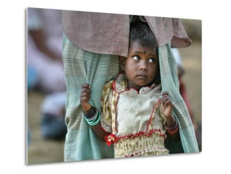 A Displaced Tamil Child Hangs to Her Father's Sarong-Gemunu Amarasinghe-Metal Print