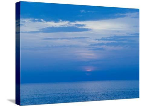 Sunset over the Tyrrhenian Sea, Forio, Ischia, Bay of Naples, Campania, Italy-Walter Bibikow-Stretched Canvas Print