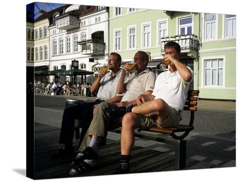 Beer Drinkers Sitting on a Bench, Sonderborg, Denmark-Holger Leue-Stretched Canvas Print