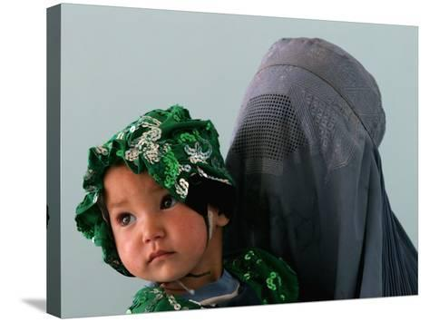 An Afghan Mother Waits with Her Daughter Before Attending Medical Care--Stretched Canvas Print