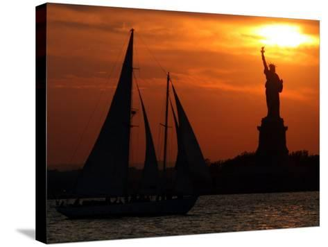 The Sun Sets Behind the Statue of Liberty on the Longest Day of the Year--Stretched Canvas Print