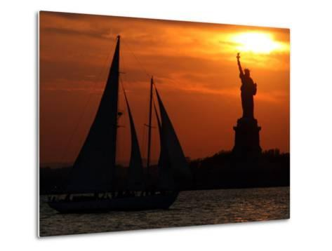 The Sun Sets Behind the Statue of Liberty on the Longest Day of the Year--Metal Print