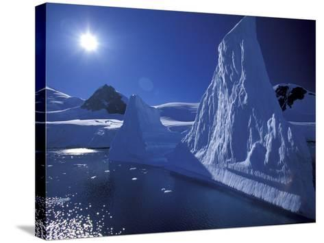 Iceberg Grounded near Shore in Paradise Bay, Antarctic Peninsula, Alaska, USA-Hugh Rose-Stretched Canvas Print