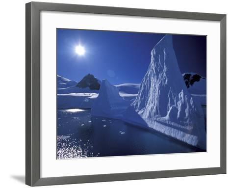 Iceberg Grounded near Shore in Paradise Bay, Antarctic Peninsula, Alaska, USA-Hugh Rose-Framed Art Print