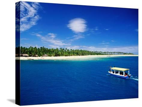Boat in Lagoon, Plantation Island Resort, Fiji-Peter Hendrie-Stretched Canvas Print