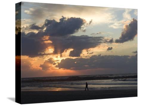 Israel, Man Walking on Beach, Tel Aviv, Israel-Keenpress-Stretched Canvas Print