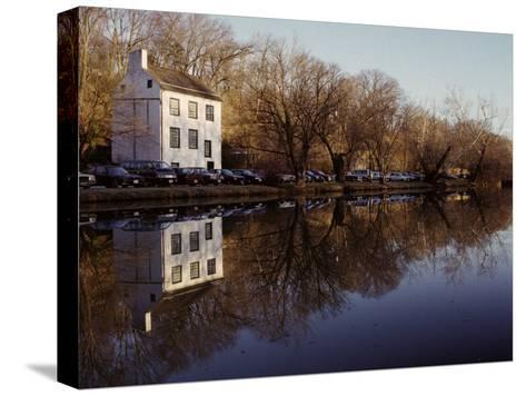 An Old Lockhouse Reflected in the C & O Canal-Stephen St^ John-Stretched Canvas Print