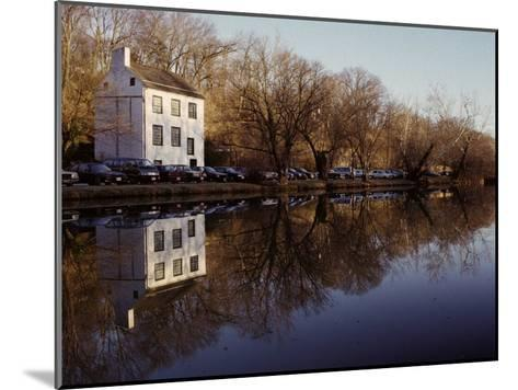 An Old Lockhouse Reflected in the C & O Canal-Stephen St^ John-Mounted Photographic Print