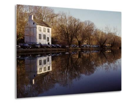 An Old Lockhouse Reflected in the C & O Canal-Stephen St^ John-Metal Print
