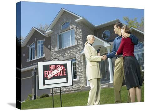 Real Estate Owner Selling Home to Young Couple--Stretched Canvas Print
