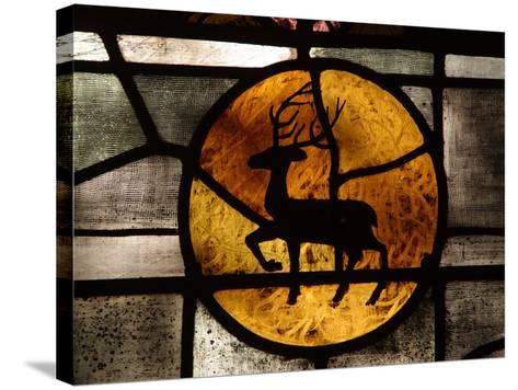 The Silhouette of a Deer in an Orange Circle on a Stained Glass Window--Stretched Canvas Print