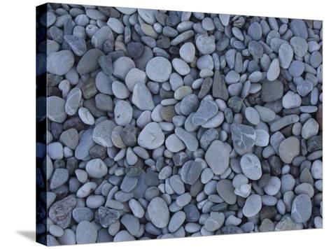 Close-up of Many Colorful Pebbles Under Clear Blue Water--Stretched Canvas Print