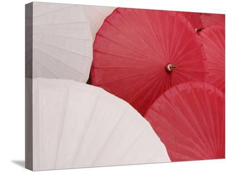 Colorful Open Asian Parasols--Stretched Canvas Print
