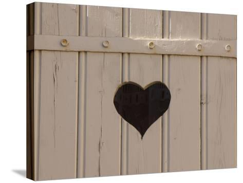 A White Picket Fence with a Black Heart Cut Out--Stretched Canvas Print