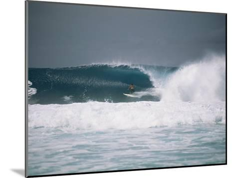 Surfer Riding a Wave in the Bonsai Pipeline in Oahu-Todd Gipstein-Mounted Photographic Print