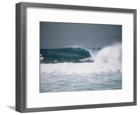 Surfer Riding a Wave in the Bonsai Pipeline in Oahu-Todd Gipstein-Framed Art Print