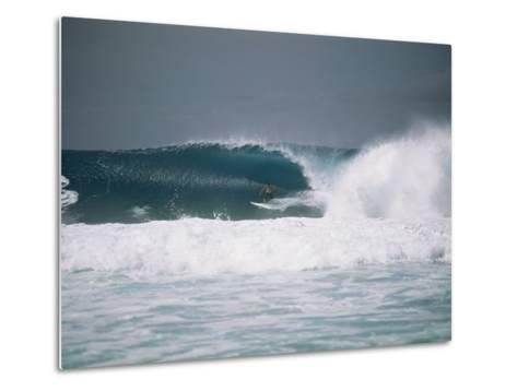 Surfer Riding a Wave in the Bonsai Pipeline in Oahu-Todd Gipstein-Metal Print