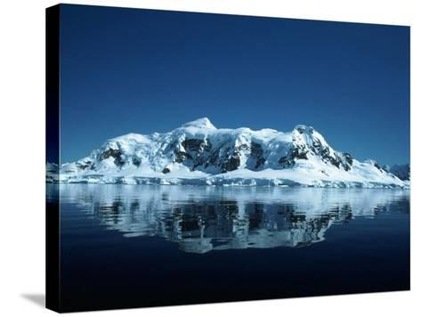 Glacier and Reflection, Paradise Bay, Antarctica-Yvette Cardozo-Stretched Canvas Print