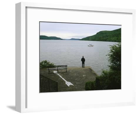 A Man Looks out at a Sailboat Anchored on Otsego Lake-Raymond Gehman-Framed Art Print