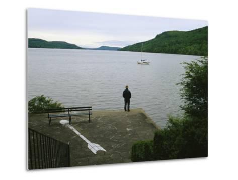 A Man Looks out at a Sailboat Anchored on Otsego Lake-Raymond Gehman-Metal Print