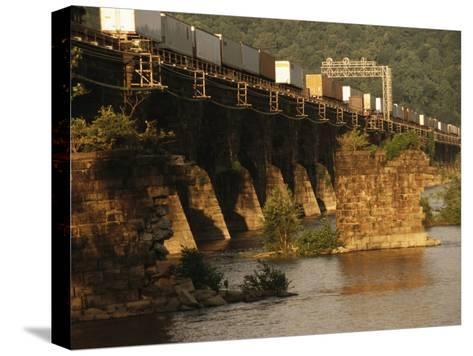 A Freight Train Crosses the Rockville Bridge-Raymond Gehman-Stretched Canvas Print