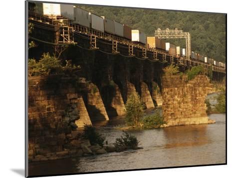 A Freight Train Crosses the Rockville Bridge-Raymond Gehman-Mounted Photographic Print