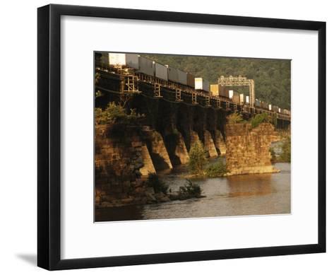 A Freight Train Crosses the Rockville Bridge-Raymond Gehman-Framed Art Print
