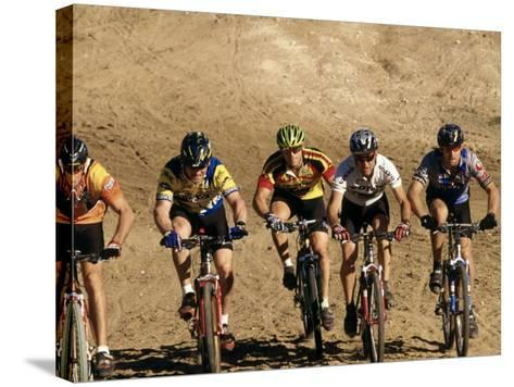 Group of People Riding Bicycles in a Race--Stretched Canvas Print